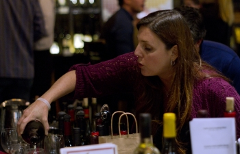 kathy-pouring-wine-at-counter